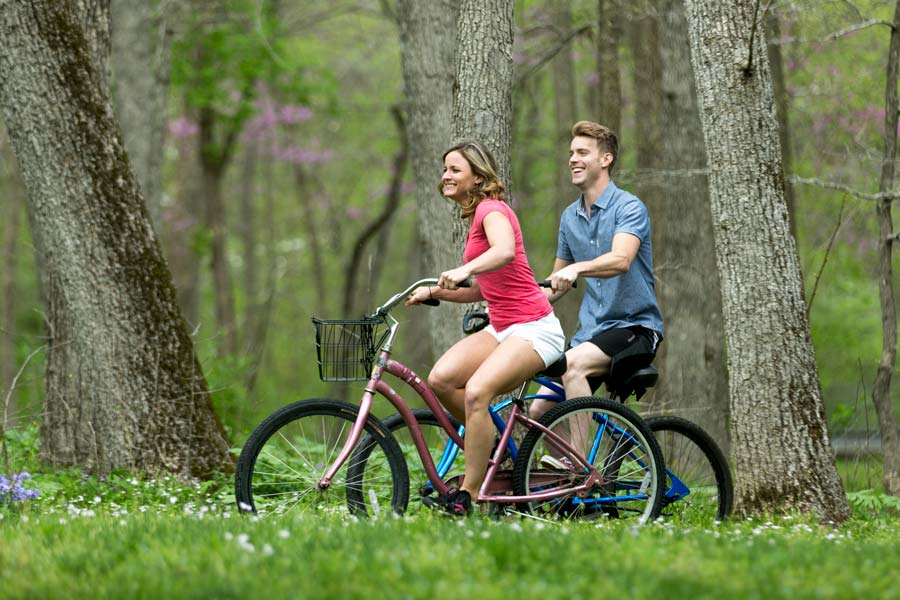 Couple Bike Riding at Dogwood Canyon