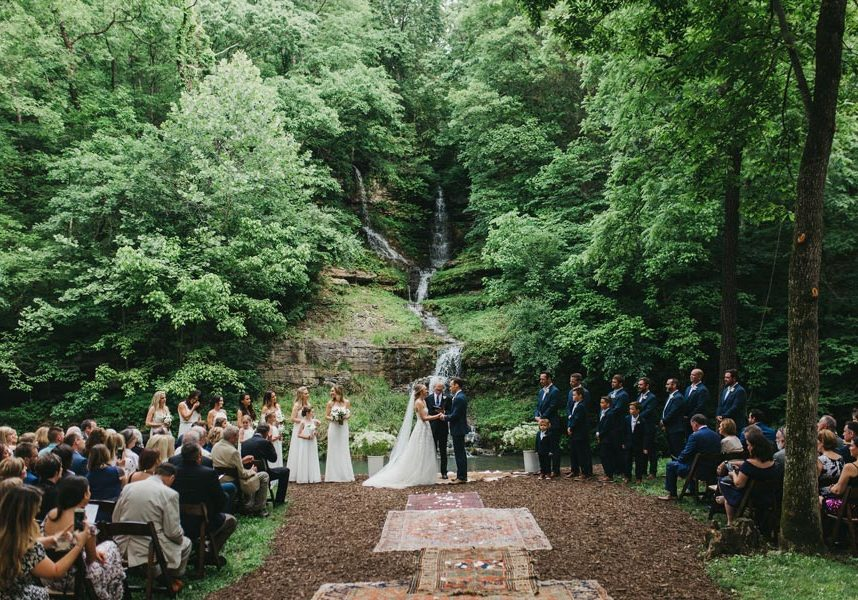 Wedding ceremony in front of waterfall